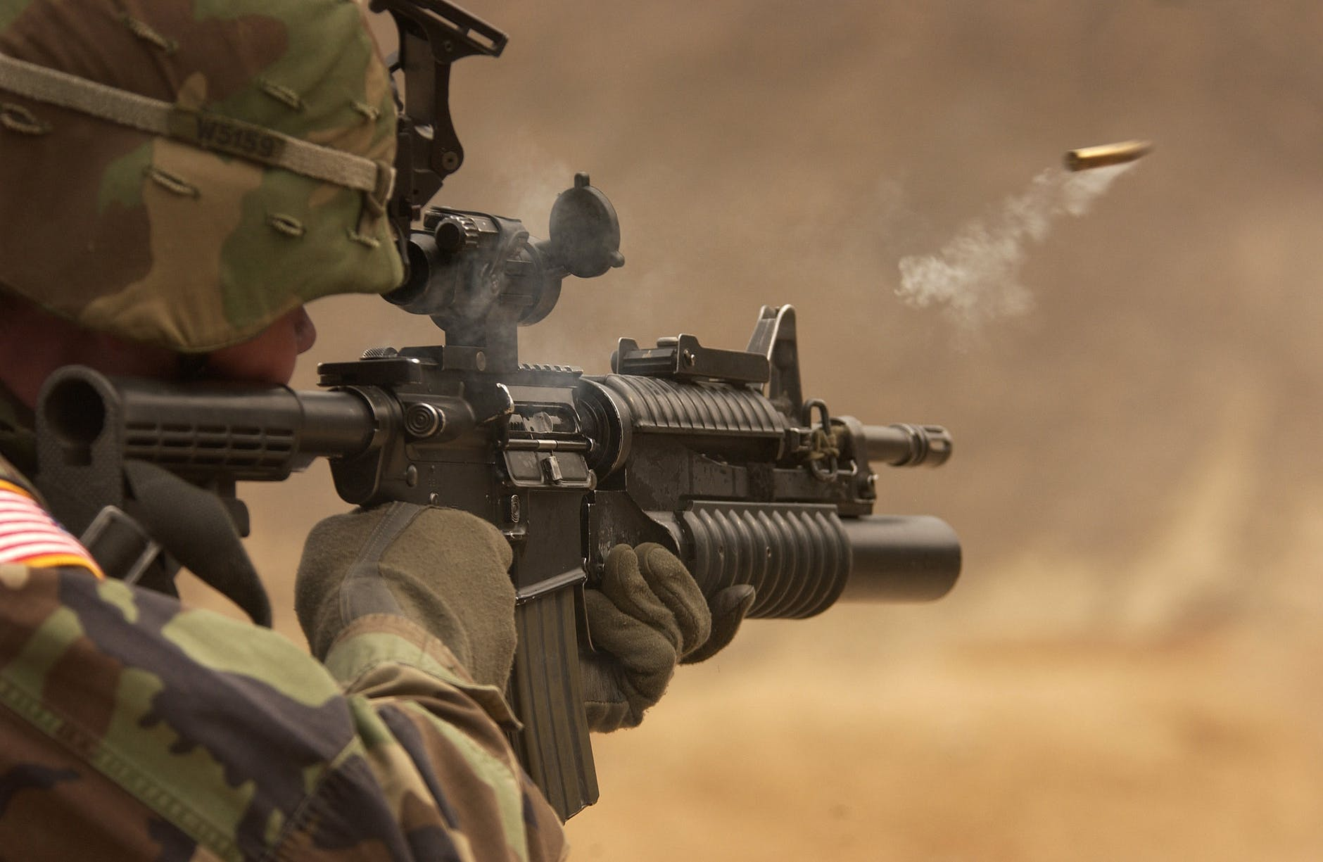 automatic weapon bullet camouflage close up